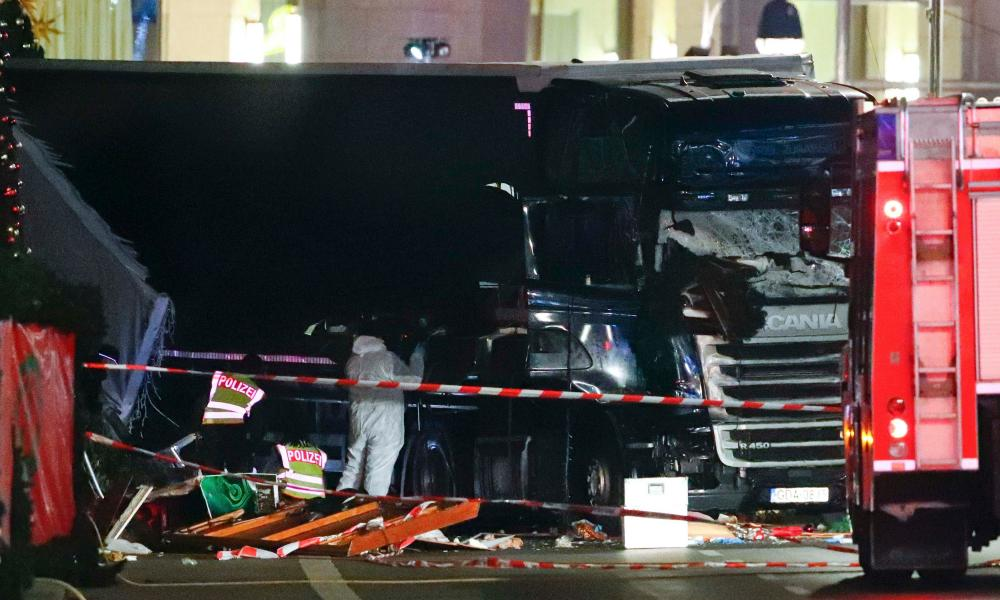 Police investigators inspect the truck that ploughed through a Berlin Christmas market.