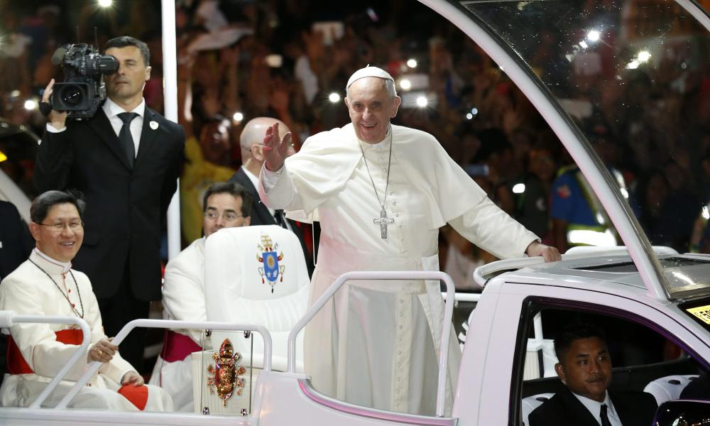 Pope Francis waves to Filipino well wishers at a street in Manila, Philippines