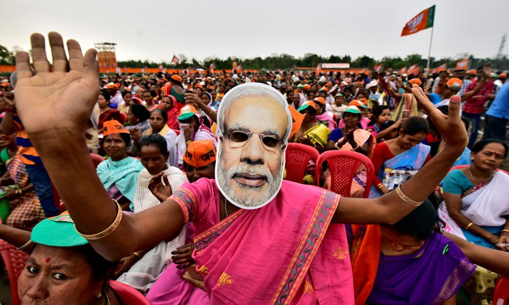 A woman wearing a mask of Modi at a recent campaign rally.