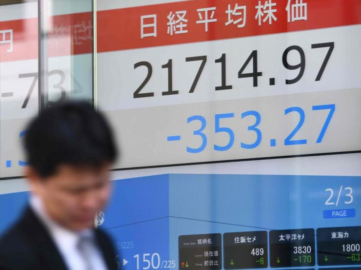 A security company in Tokyo, where stocks fell after losses on Wall Street on Wednesday night
