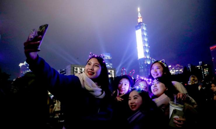 Selfie time against the backdrop of the Taipei 101 skyscraper in Taiwan.