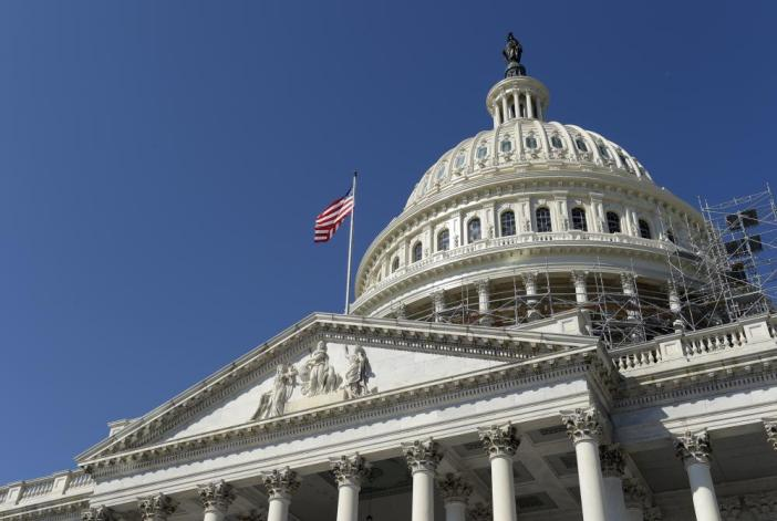 An American flag flies over Capitol Hill in Washington.