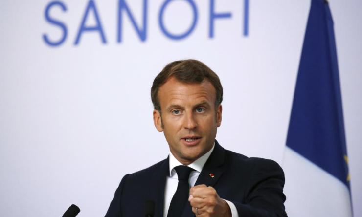 French president Emmanuel Macron delivers a speech at Sanofi Pasteur's vaccine unit in Marcy-l'Etoile, near Lyon.