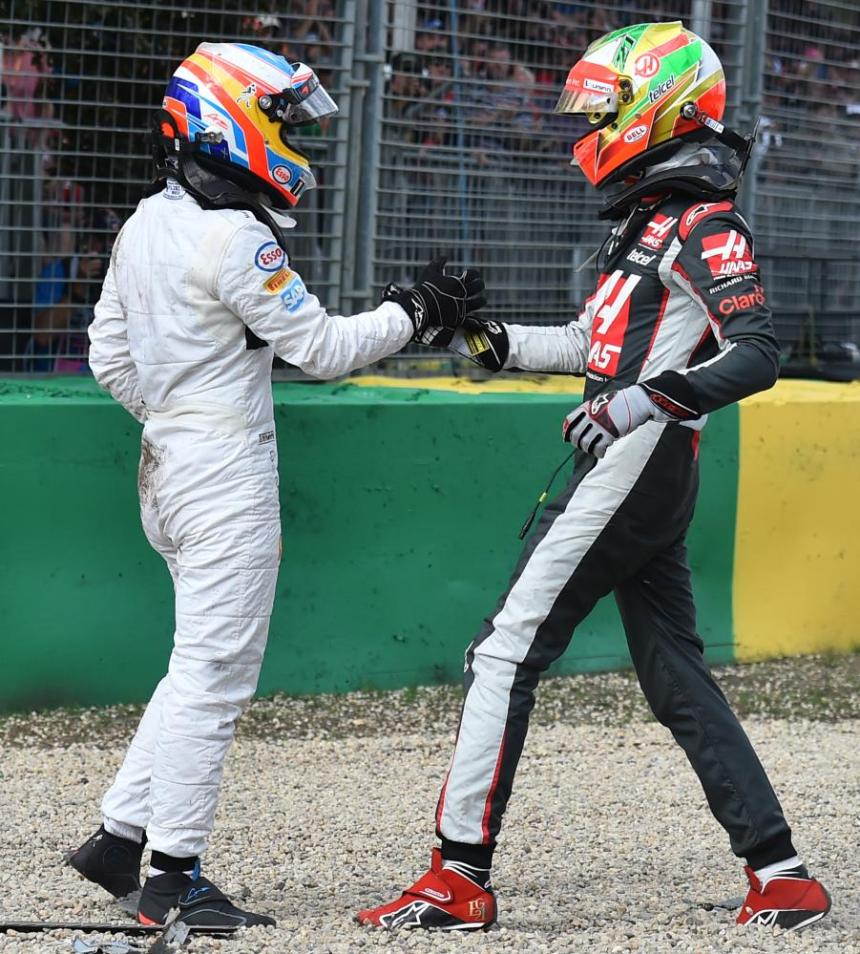 Fernando Alonso and Esteban Gutierrez check on each other after Alonso's car was reduced to a mangled wreck.