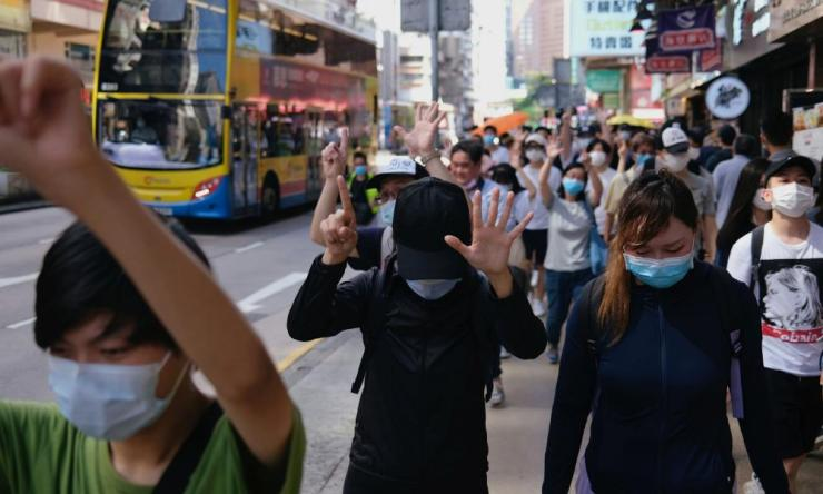 "Pro-democracy protesters raise their hands up as a symbol of the ""Five demands, not one less"" during a march against the looming national security legislation in Hong Kong, China June 28, 2020. Credit: REUTERS/Tyrone Siu"