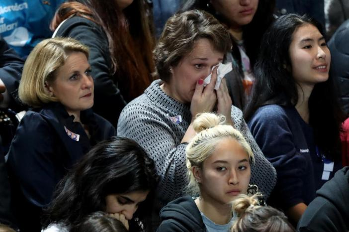 A woman wipes her eyes as she watches voting results come in at Hillary Clinton's election night event.