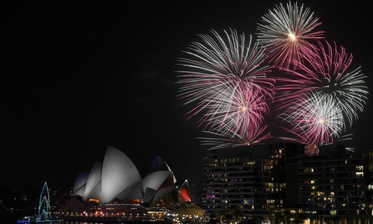 Fireworks explode over Sydney Harbour.