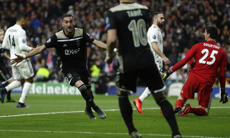 Ajax's Hakim Ziyech celebrates scoring the opening goal.