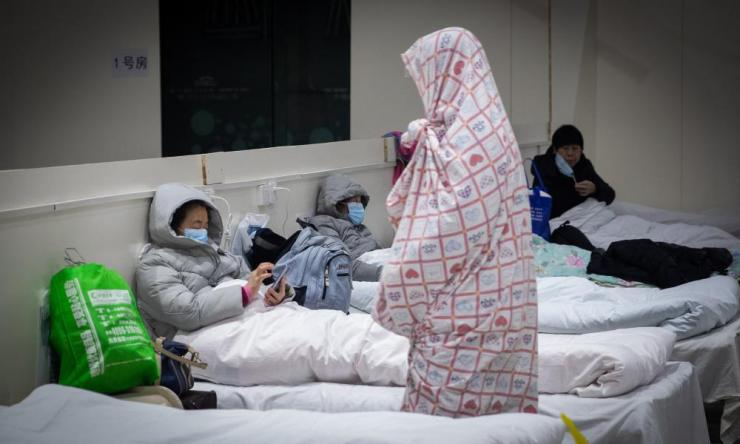Patients infected by the coronavirus rest at a makeshift hospital at Wuhan International Convention and Exhibition Centre.