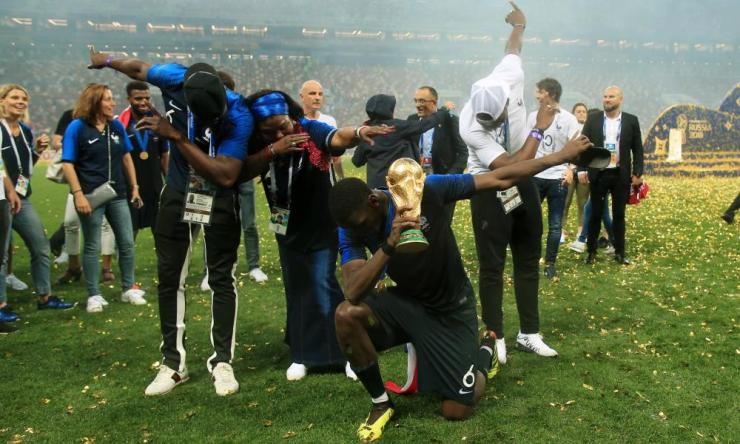 Paul Pogba of France celebrates with his mother, Yeo, and brothers Mathias and Florentin as they perform a dab with the trophy.