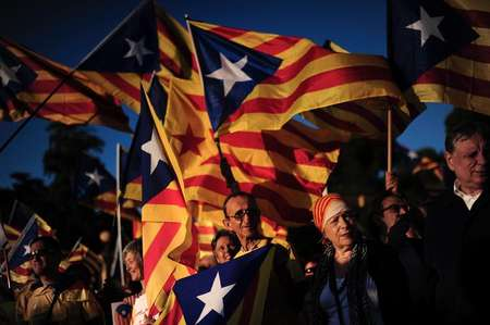 Demonstrators wave Catalan flags as they call for independence from Spain, during a rally outside the Pedralbes Palace in Barcelona, on October 23, 2013 ( Josep Lago (AFP/File) )