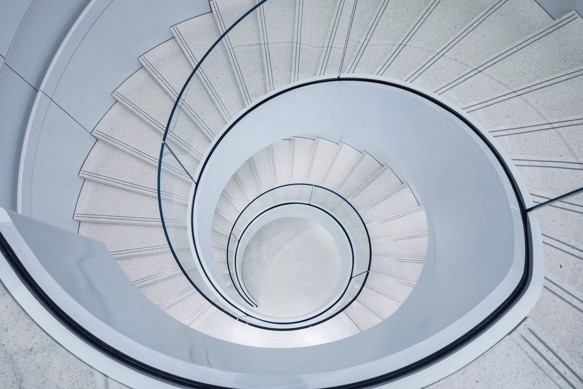 Check Out The Glass Spiral Staircase In Apple S Renovated Shibuya | Spiral Staircase With Glass Railing | Exterior | In India Staircase | Stair Wood Bracket | Glass Insert | Inside Glass