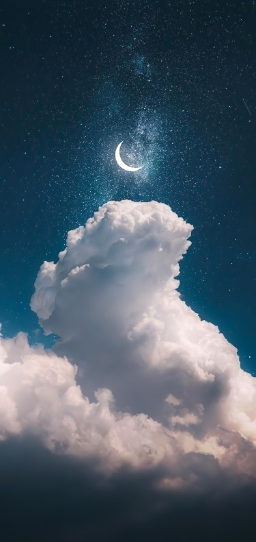 Cloudy sky with crescent moon