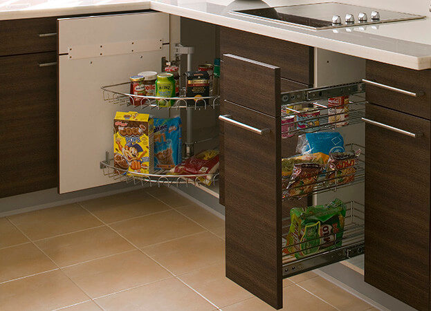 Bottom cabinets equipped with pullout shelves are particularly appropriate to store heavy kitchen items such as pots and pan.