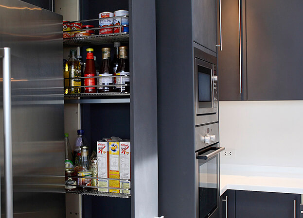 the perfect space for a slide-out pantry you can use to stock canned goods or spices.