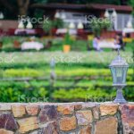 Abstract Front Stone Wall Over Blur Restaurant Garden In Background Outdoor Dinner Concept Stock Photo Download Image Now Istock