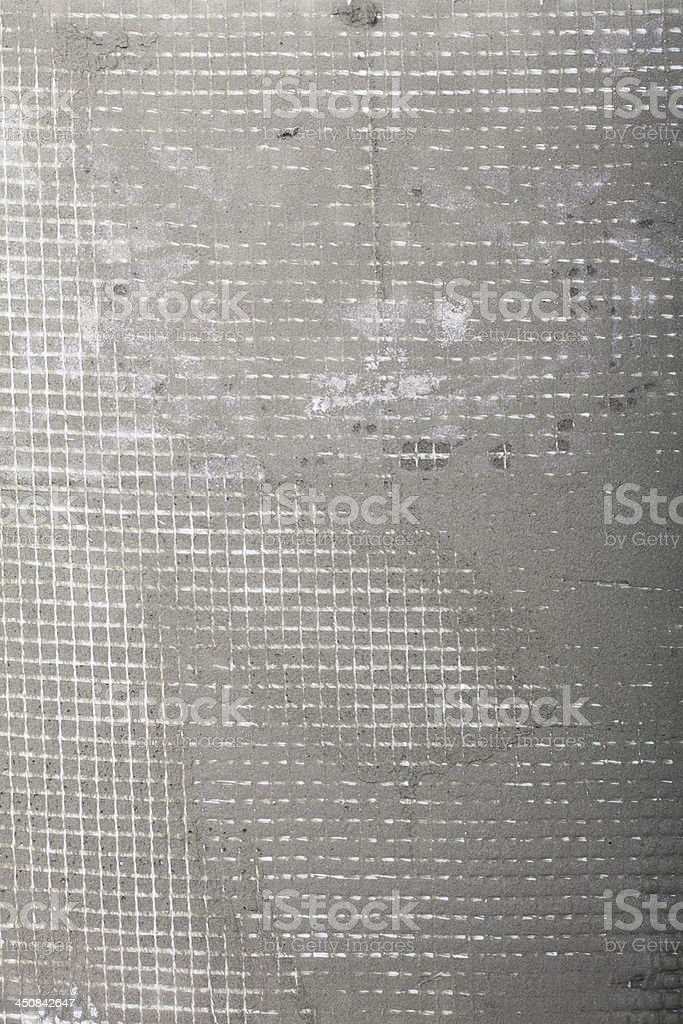 https www istockphoto com photo applying tile adhesive with reinforcement mesh on floor gm450842647 29450982