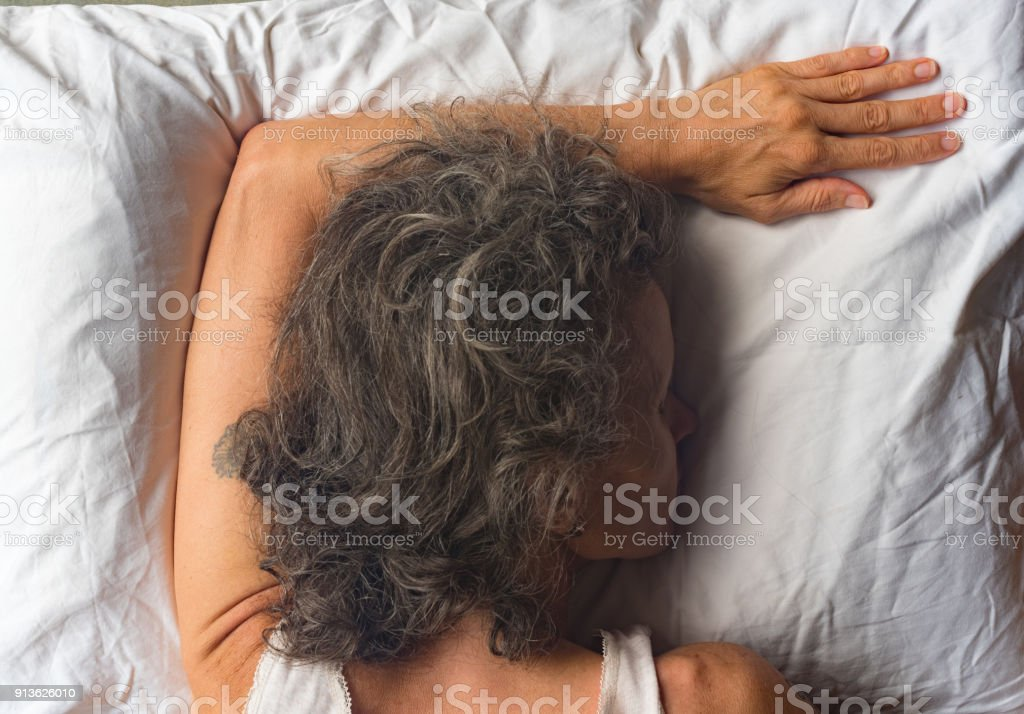 63 face down in pillow stock photos pictures royalty free images istock