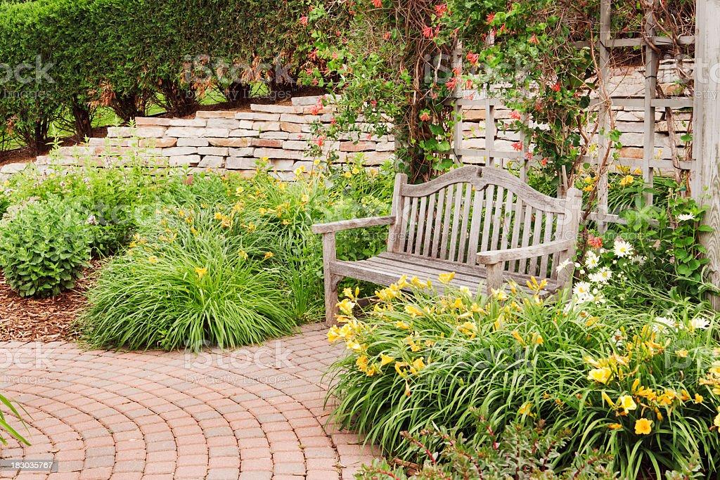 https www istockphoto com photo backyard garden outdoor landscape brick patio stone wall wooden bench gm183035767 14274345