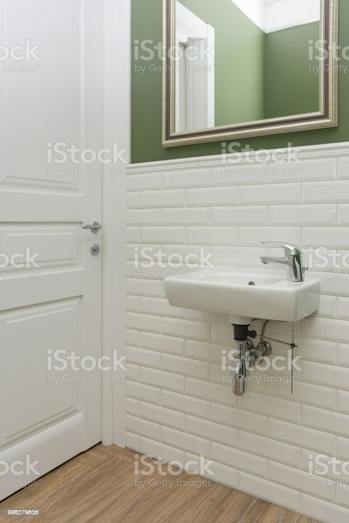 Bathroom Toilet Room Interior Closeup The Walls Are Painted Green Covered With Decorative Ceramic Tiles With White Glossy Bricks Stock Photo Download Image Now Istock
