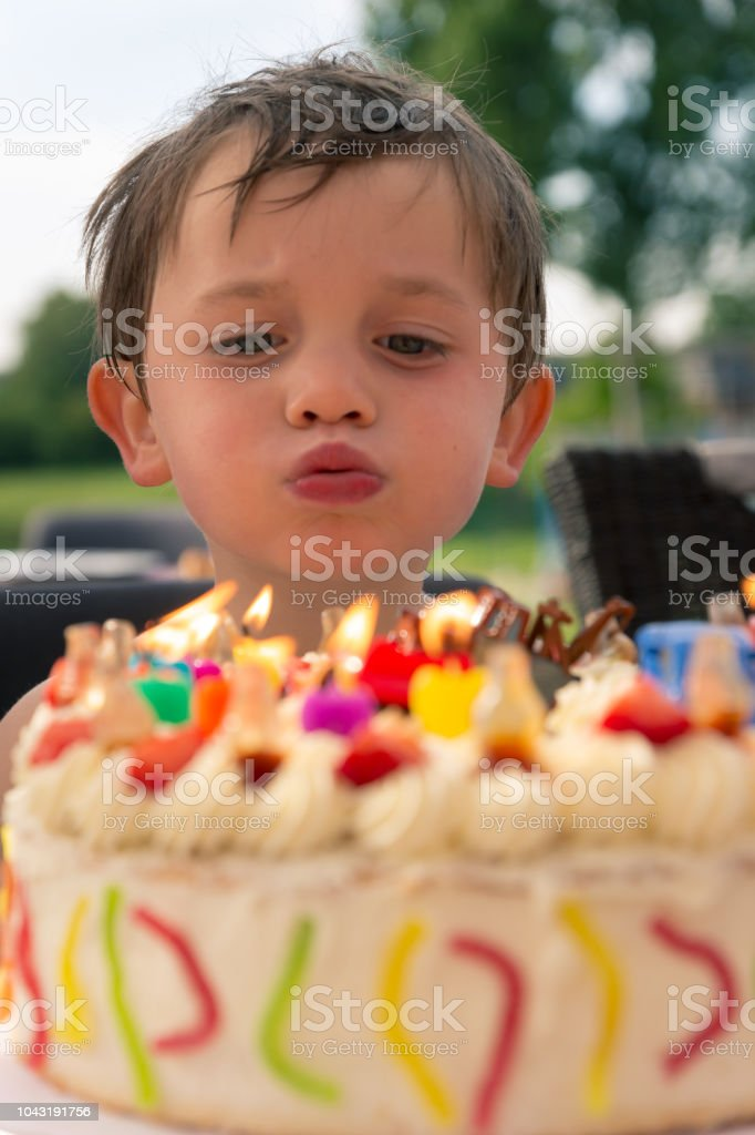 Boy In Frond Of Birthday Cake Stock Photo Download Image Now Istock