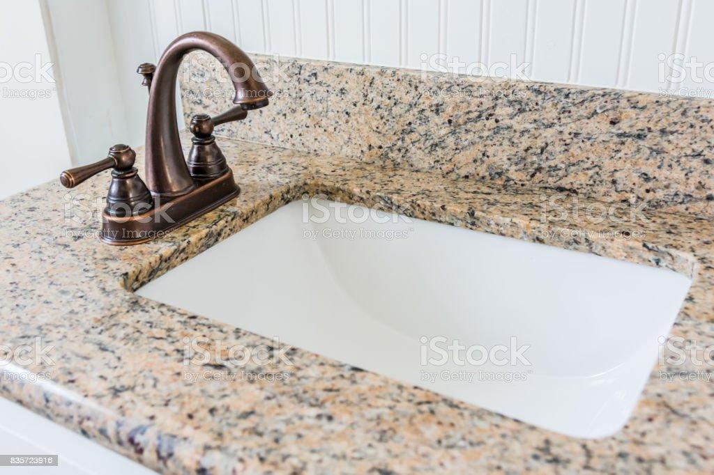 bronze bathroom vanity faucet and sink stock photo download image now istock