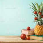 Christmas Holiday Concept With Pineapple As Alternative Christmas Tree And Books Stock Photo Download Image Now Istock