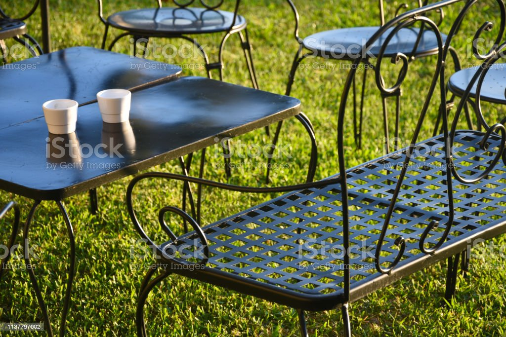close up of metal patio furniture on grass stock photo download image now istock