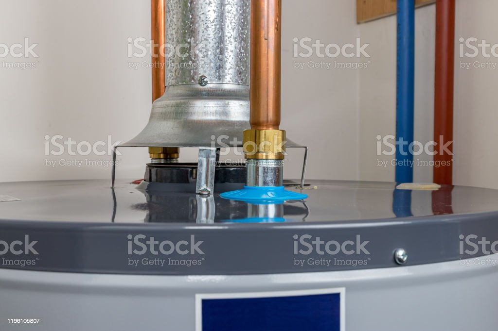 closeup of natural gas or propane hot water heater flue exhaust vent pipe and copper plumbing pipe concept of home maintenance and repair stock photo download image now istock