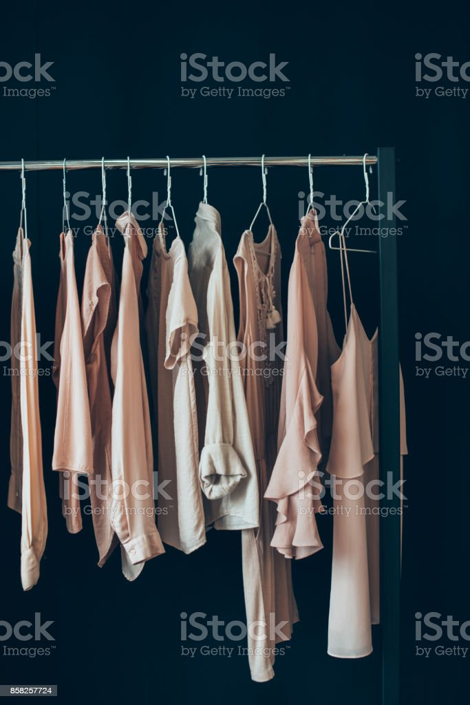https www istockphoto com photo clothing hanging on clothes rack gm858257724 141645221