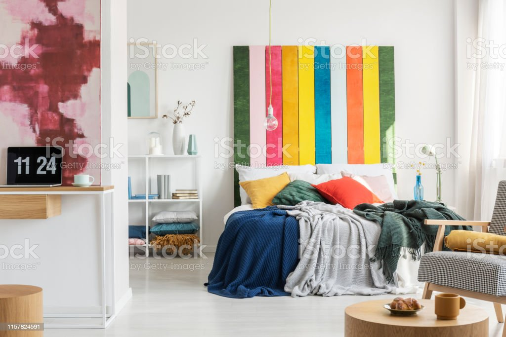 https www istockphoto com photo colorful headboard in king size bed with pillows and blanket and home office with gm1157824591 316048799