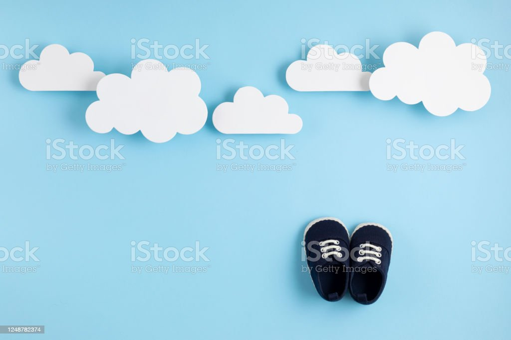 cute newborn baby boy shoes with festive decoration over blue background baby shower birthday invitation or greeting card stock photo download image now istock