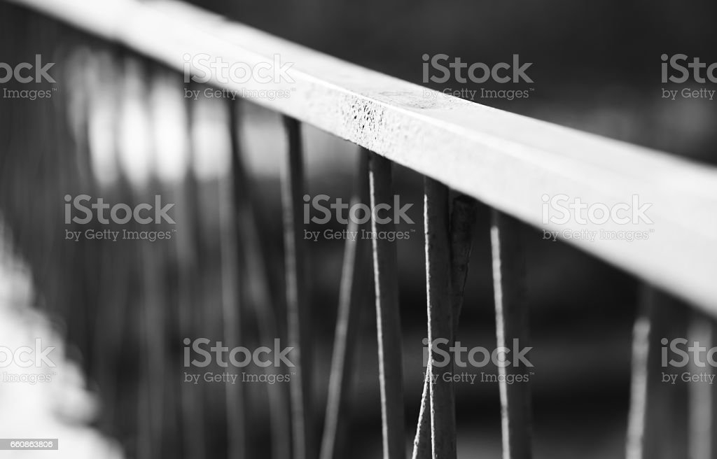 Diagonal Black And White Banister Bokeh Background Stock Photo | Black And White Banister | Round | Deck | Light Wood Banister | Light Grey Grey White | Wrought Iron