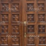 Double Wooden Door With Beautiful Design And Carved Handle Stock Photo Download Image Now Istock