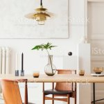 Eclectic And Elegant Dining Room Interior With Design Sharing Table Chairs Gold Pedant Lamp Abstract Paintings And Stylish Accessories Tropical Leafs In Vase Eclectic Decor Brown Wooden Parquet Stock Photo Download