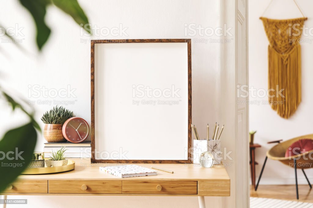 https www istockphoto com photo elegant scanidnavian interior of apartment with mock up poster frame gold armchair gm1141409889 305779205