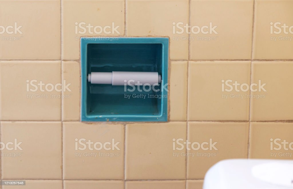 empty toilet paper holder on tile wall stock photo download image now istock