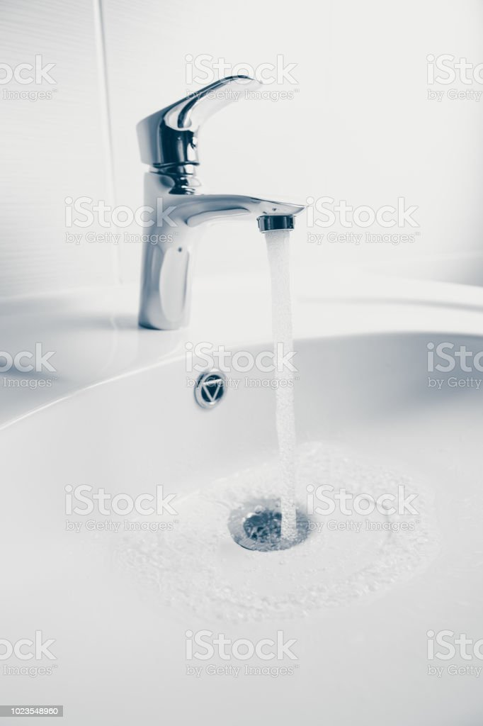 https www istockphoto com photo faucet and wash sink with flowing water gm1023548960 274711092