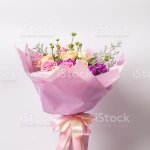 Flower Bouquet Wrapped With Paper Standing On White Stock Photo Download Image Now Istock