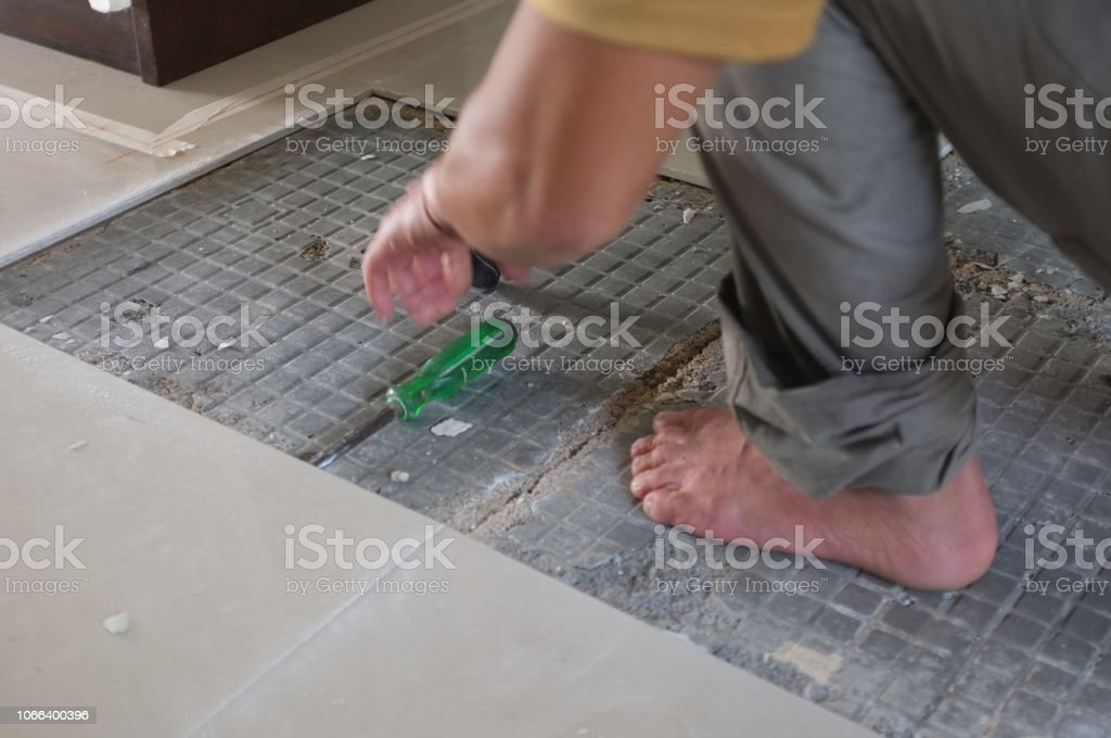 homemade replacing floor ceramic tiles broken and a tile adhesive stock images page everypixel