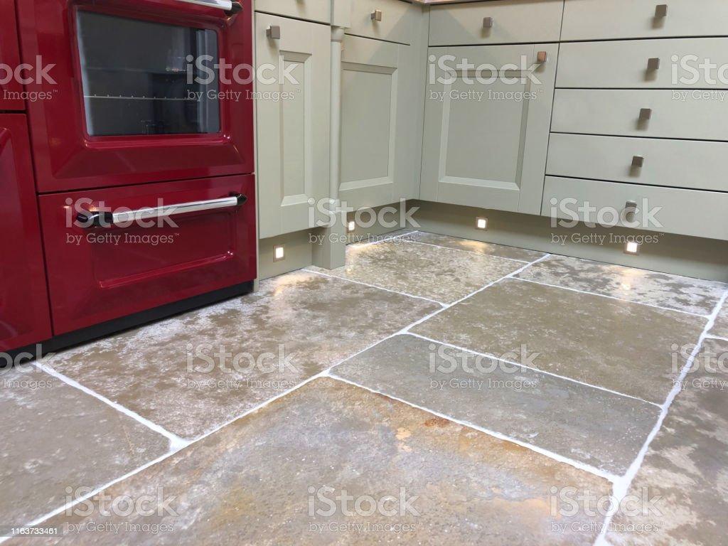 image of spot halogen lights under grey kitchen cabinets cupboards floor lighting in interior design of