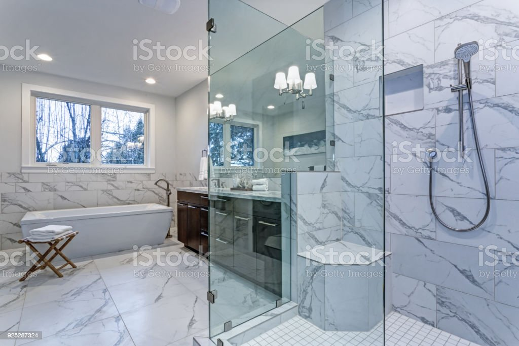 incredible master bathroom with carrara marble tile surround stock photo download image now istock