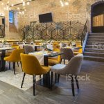 Interior Of A Modern Hotel Restaurant With Brick Wall Stock Photo Download Image Now Istock