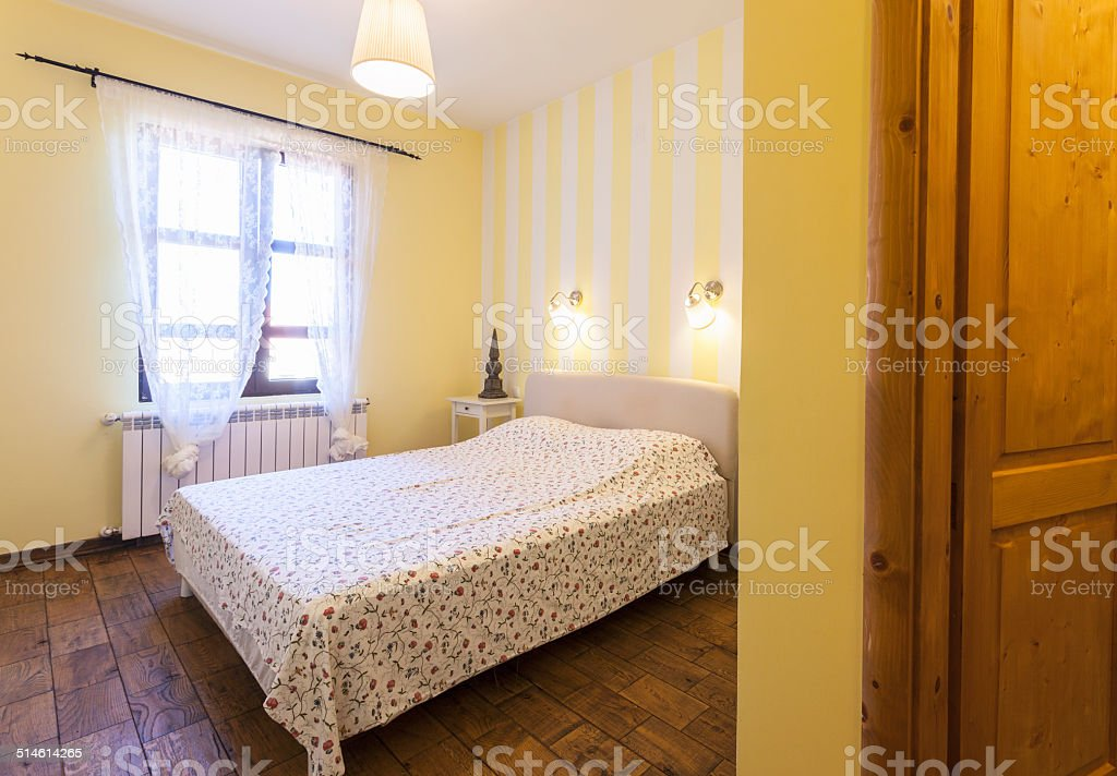 Interior Of A Simple Bedroom With Yellow Walls Stock Photo Download Image Now Istock