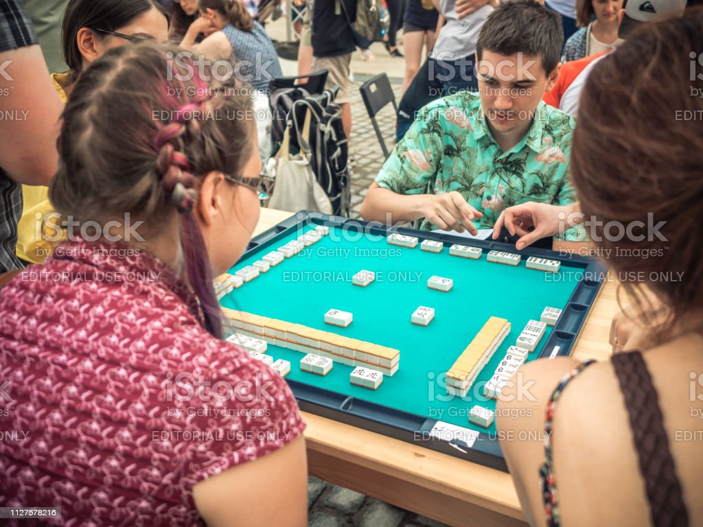 japanese festival in moscow young people playing mahjong asian tilebased game table gambling side view stock photo download image now istock