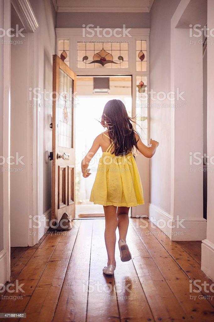 Little Girl Running Happily To An Open Front Door Stock