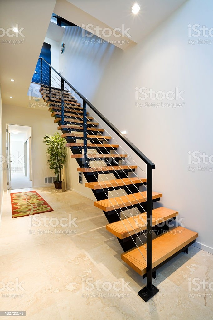 A Modern Stair With Open Wooden Treads And Metal Handrail Stock | Modern Stair Hand Railing | Creative Outdoor Stair | Wooden Stair | Decorative | Curved Metal | Diy Modern