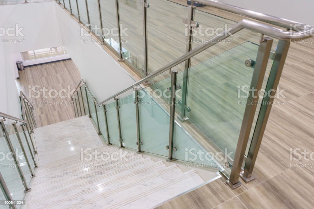 Modern White Marble Stairs With Steel And Glass Railing In A New | White And Glass Staircase | Before And After | American White Oak | Luxurious | High End Glass | White Handrail Treads
