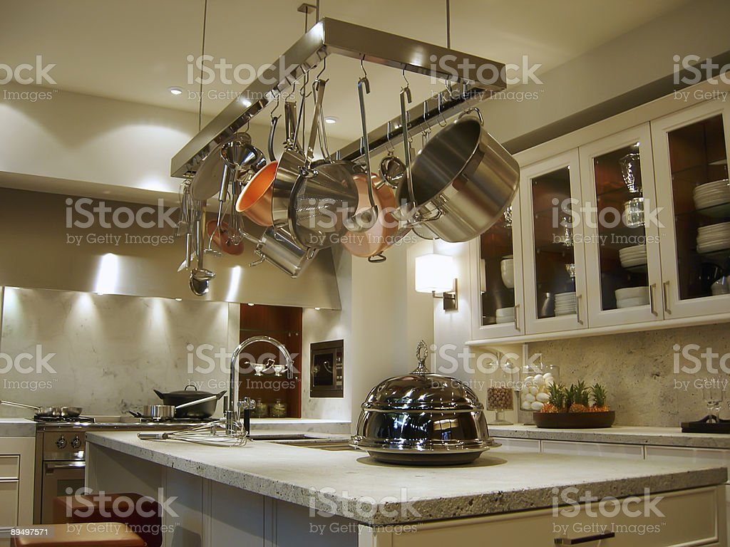 https www istockphoto com photo new modern kitchen with a rack of hanging pots and pans gm89497571 4460930