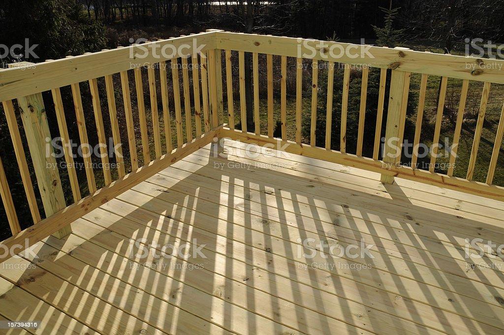 https www istockphoto com photo new pine wood stock lumber patio deck building railing shadow gm157394316 7838009